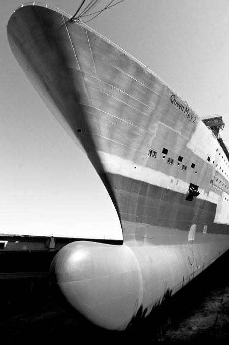 The QM2 in France, during her building process, prior to paint.  Note the size of the keel bulb specially designed for the North Atlantic.