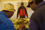 IMG (International Mountain Guides) climbing sherpas getting paid for the season on their last day at Everest Base Camp