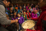 Rice is given out as a snack at the the beginning of the rice distribution at the Dumji Festival. The Dumji Festival celebrates and honors the anniversary of Guru Rinpoche birth on the lotus flower. Lama Sangwa Dorji is the founder of the earliest monastery of Khumbu and he was the first to start the Dumji festival in Pangboche about 360 years ago in order to coincide with the birth anniversary of Guru Rinpoche.