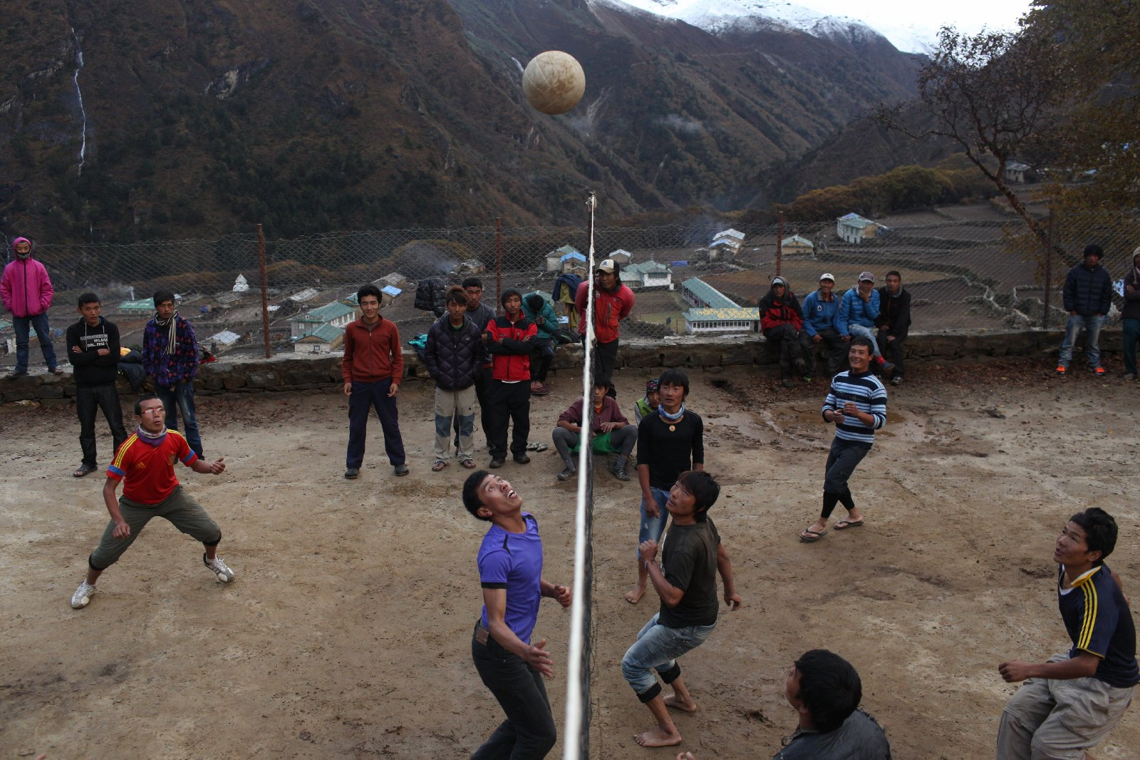 A volleyball game in Phortse between a team of Everest Summiters and a team of porters.  Games are often played with all Sherpa who work on everest.