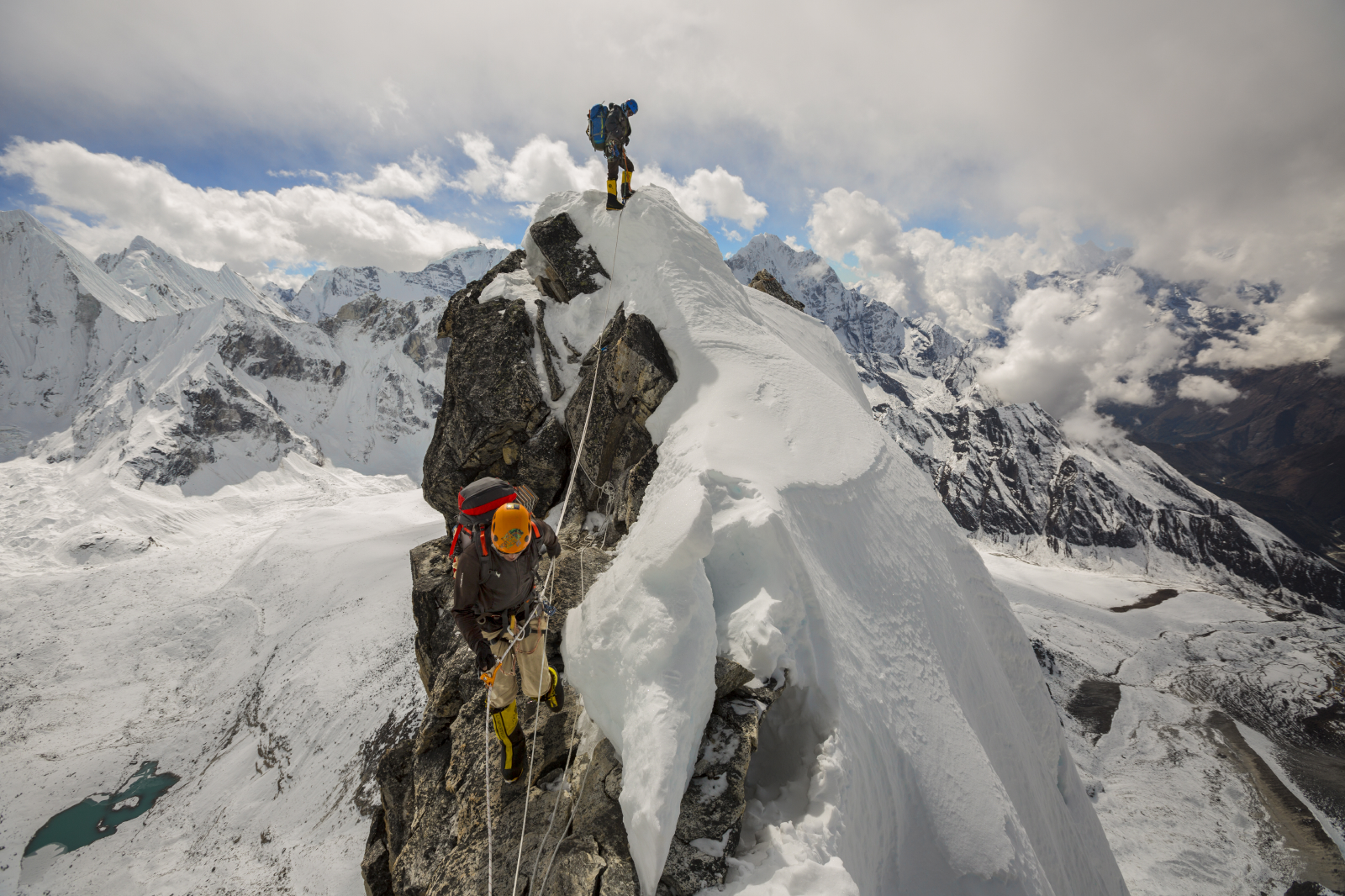Danuru (orange helmet) and Panuru Sherpa move between camp 1 and Camp 2 at the top of teh Yellow Tower on Ama Dablam on fixed lines
