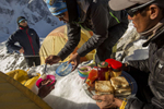Sherpas from the Himalayan Ascent team serve breakfast to clients in their tents at Camp 1 on Ama Dablam.