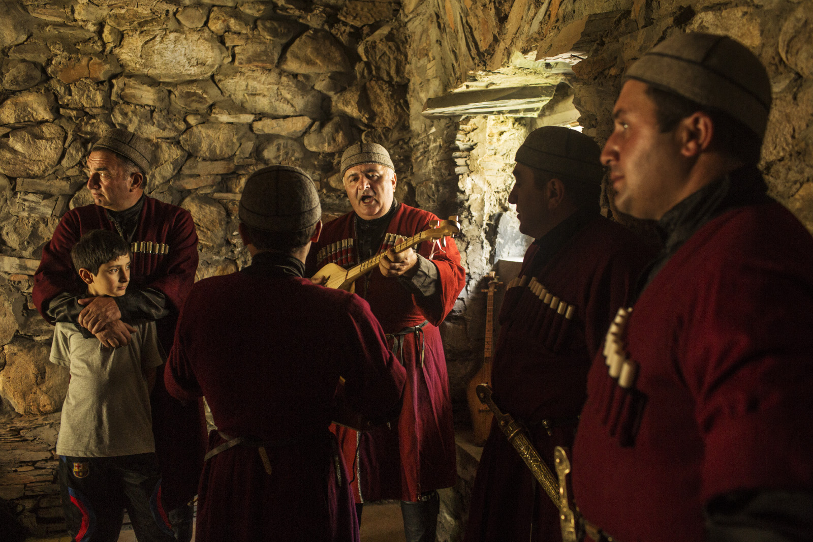 The {quote}Rhio{quote} mens choir prepares (and takes breaks) from a performance to honor a famous Svaish mountaineer who returned home from an expedition, Mestia, Svanetia.