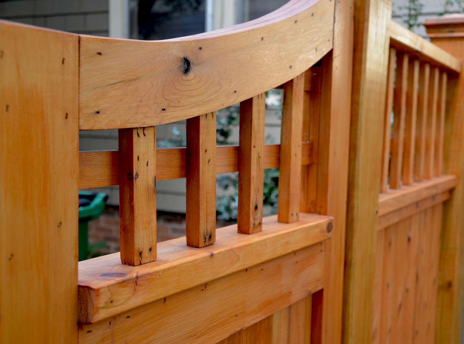 The custom cedar fencing adds to the Asian tone set throughout this design.