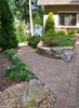 Emerging from the drive, a cobble path winds down around and through the backyard gardens. Designed without steps, it becomes the path of choice for lawnmower or wheelbarrow, as well as a cool, direct foot route to the dock on warm summer days.