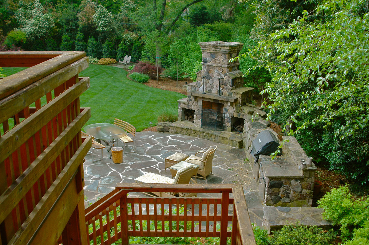 Phase two of this project began after the homeowners' deliberating for several years over desired function for their backyard. Our design allowed for more parking behind the house, which the homeowner wanted, and this area now leads down to a custom-designed upper deck  that spills int a ground level patio. This unified the space and the lawn  manages stormwater completely transforming the utility and use of the backyard environment.