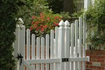 Entrance into this {quote}secret garden{quote} is accessed through the classic white picket fence...