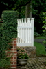 Custom picket fence on stone knee wall