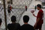 Young boys playing soccer at a abandon plot in Hamra, central neighborhood in Beirut, May 2013