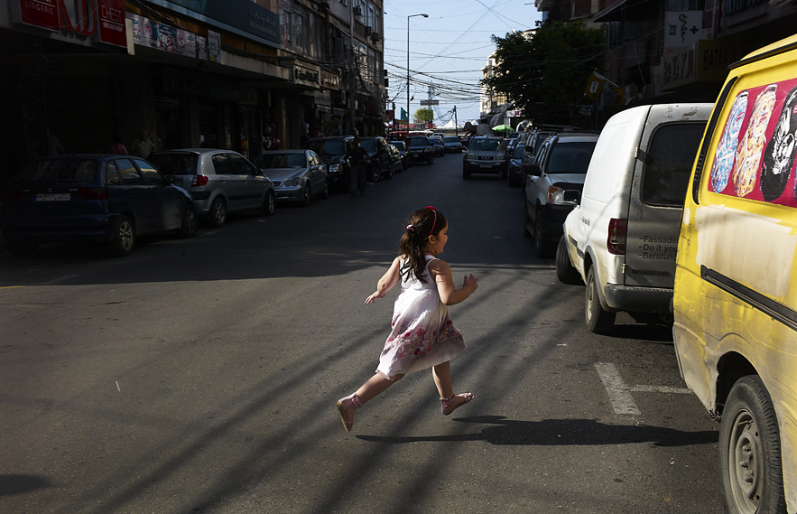 Young girl crossing alone the street in Saida, south of Beirut, May 2013