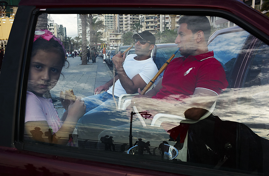 Young girl at the Corniche with men smoking, Beirut, May 2013