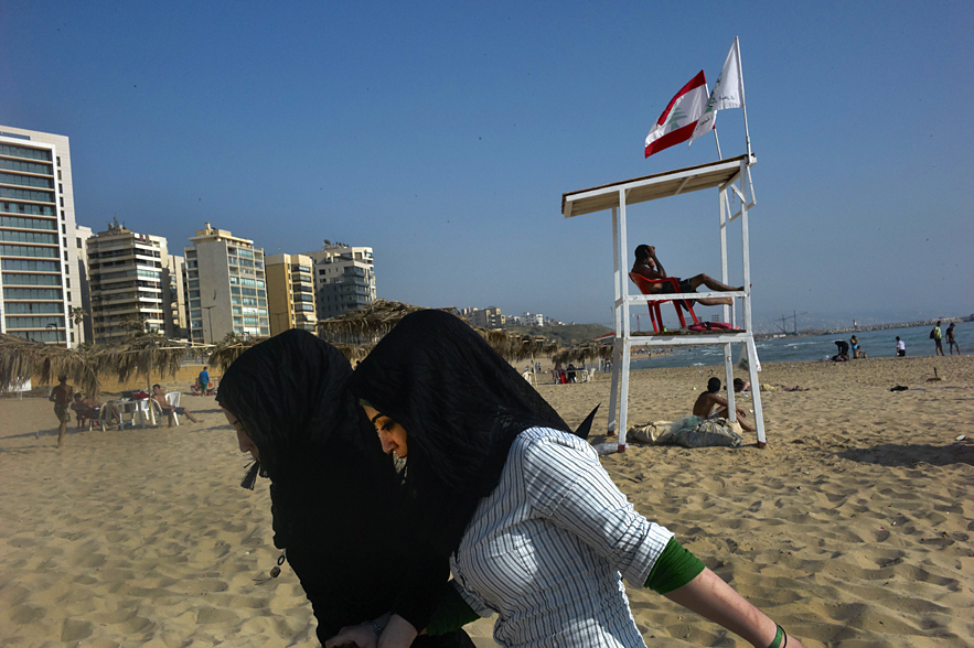 Two yound ladies leaving the beach, Beirut, May 2013