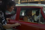 Habana_red_car_with_woman_in_white_through_the_window_for_web