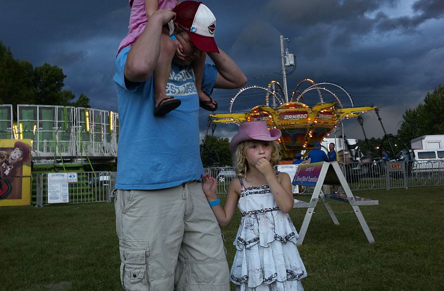 Father and daughter at a local county fair in Farmington.