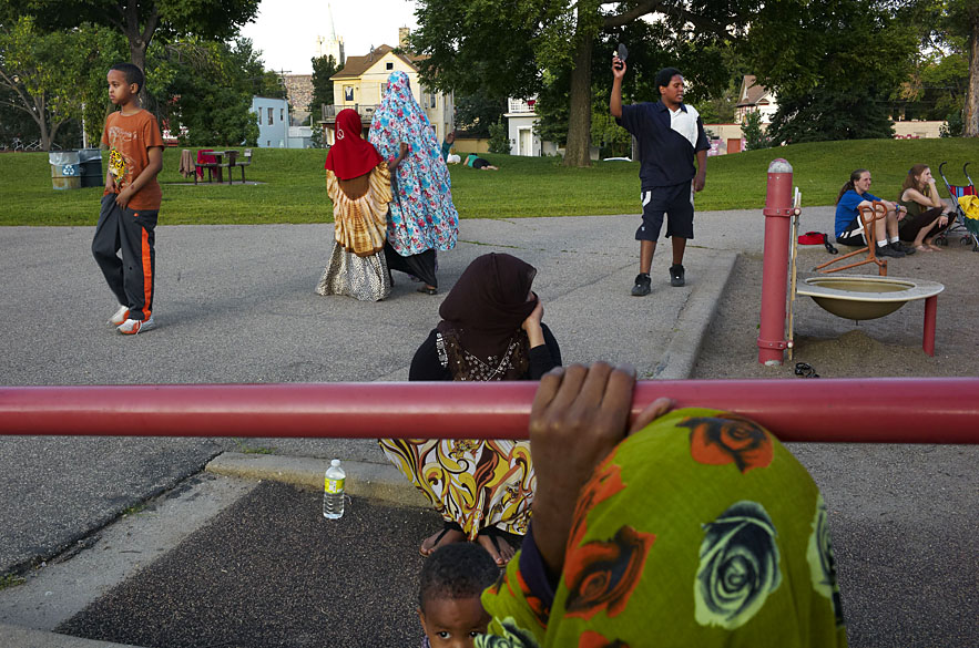 Somali women with their children at a park near downtown Minneapolis.