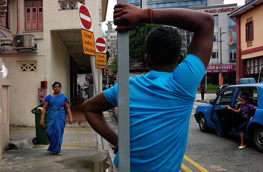 Man standing and waiting, Little India.