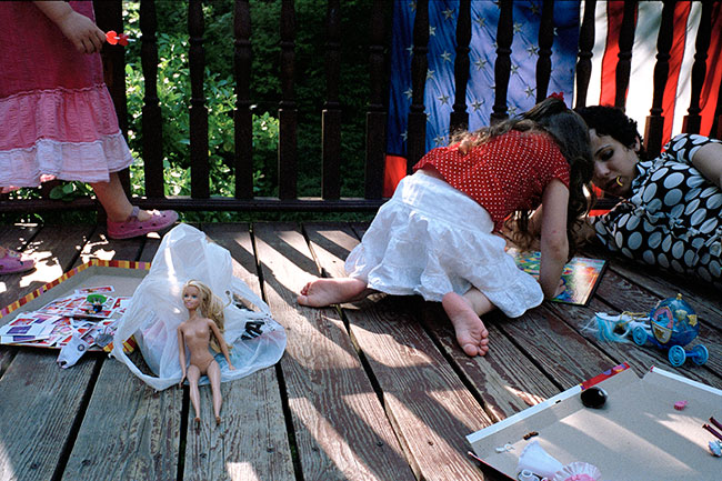 Gitty is playing with her daughter Esther Miriam at a friend's house in Monsey. Esther Miriam enjoys playing with Barbie dolls and other toys that are forbidden by Orthodox practice in the Satmar community because they are considered too sexual.