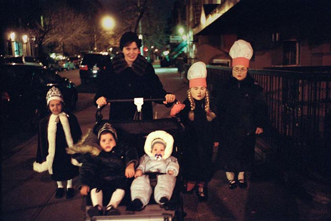 A Hasidic woman with her kids dressed up for Purim.  According to the Washington Post Hasidic women have an average of eight children.