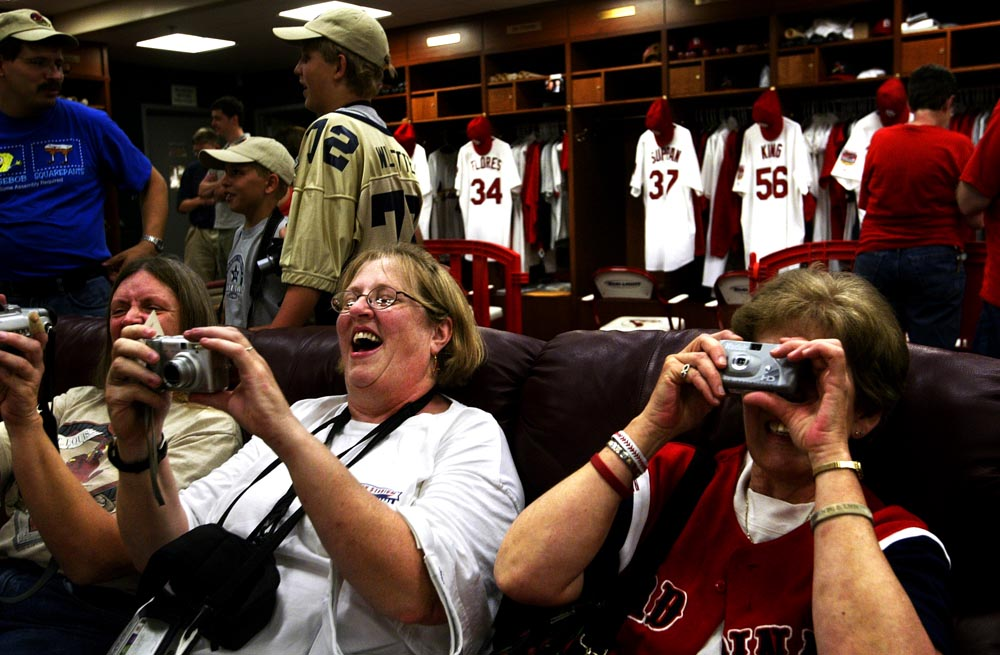 Friends, from left, Nancy Schuster from Hazelwood, Mo., Yvonne Suess from Brentwood, Mo. and Margaret Bruno from St. Charles, Mo. document their visit inside the Cardinals' clubhouse during the Cardinals Campout. The women were three of more than 300 people that had the opportunity to tour the clubhouse, dugout and bullpens during their overnight stay at Busch Stadium.
