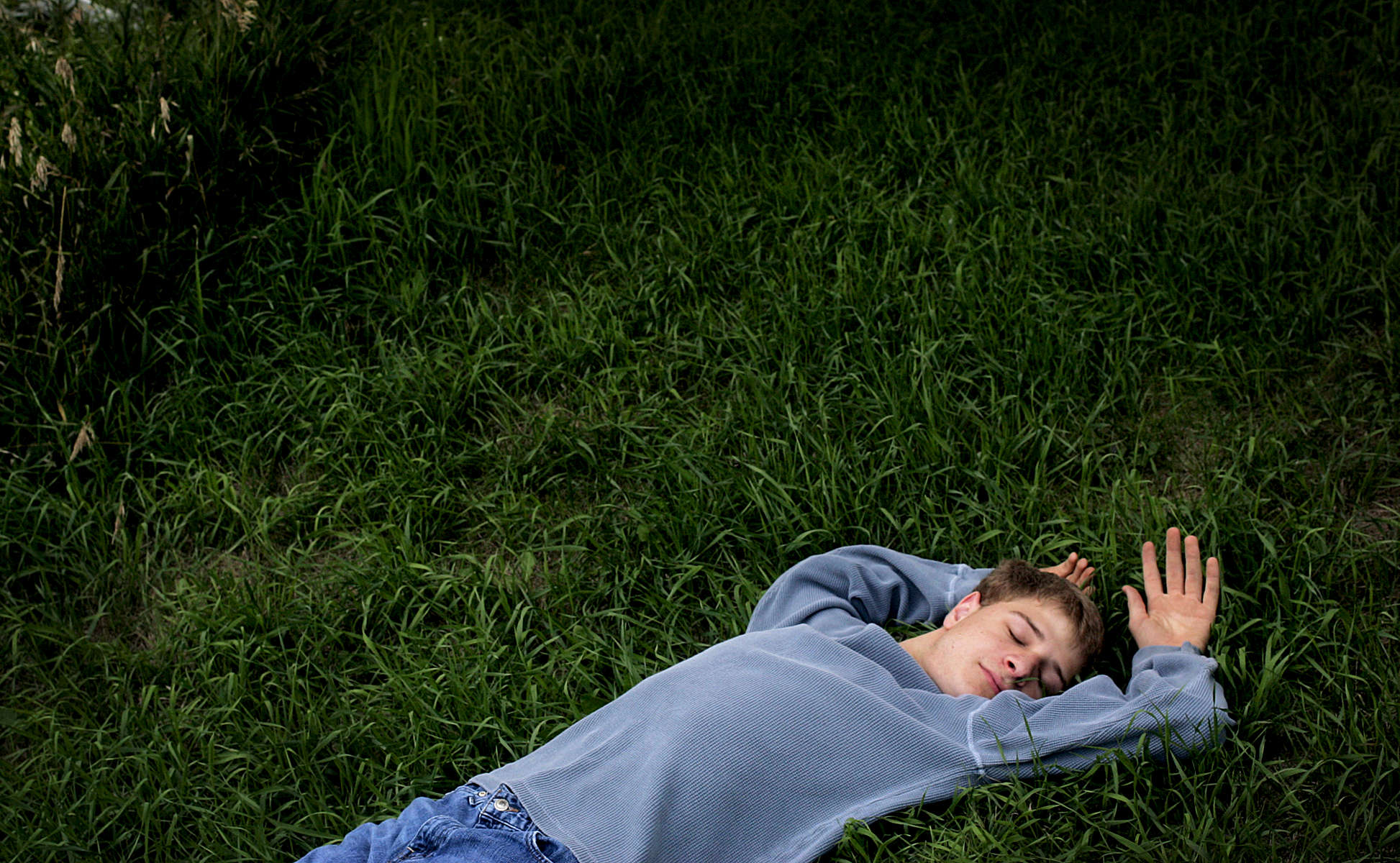 Stefan Kavan relaxes in the grass while waiting for a senior portrait photo session in New Prague, Minn. Kavan, who is autistic, is will be starting his senior year at New Prague High School where is involved in choir and the Knowledge Bowl team.