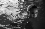 Abdishakur Mahboub, 12, pauses in the pool at the Kandiyohi County Area Y.M.C.A. in Willmar.