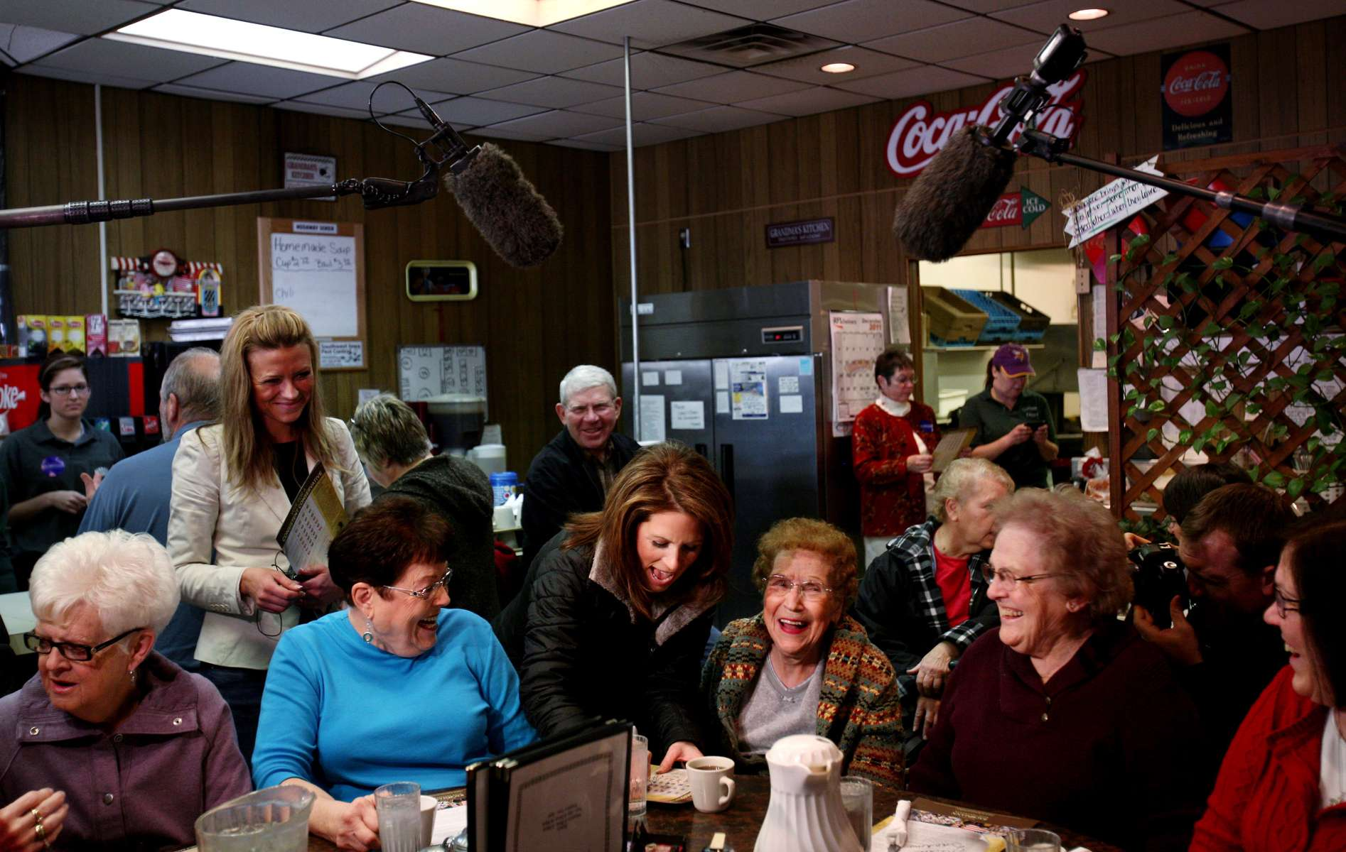 Republican presidential candidate Michele Bachmann, center, jokes with patrons at Nodaway Diner in Greenfield, Iowa.