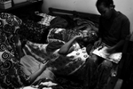 Hodan Ali, 12, relaxes with her sister and cousin in her bedroom of their Minneapolis home.