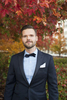 portrait of groom against fall leaves in Hoboken before wedding at Kolo Klub