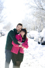 engaged couple during their snowy Hoboken engagement session. Hoboken wedding photographers