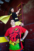 engaged couple dressed as superheros batman and robin during their creative engagement session. Hoboken wedding photographers
