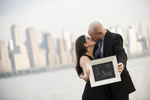 portrait of couple against NYC skyline on their first wedding anniversary.