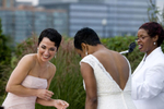 Brides laughing during wedding ceremony at Liberty House. NJ gay friendly wedding photographers