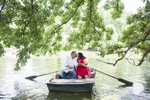 engaged couple kissing in a row boat at the Boat House in Central Park. NYC wedding photographers