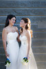 brides laughing together on their wedding day. Gay wedding. NYC wedding photographers