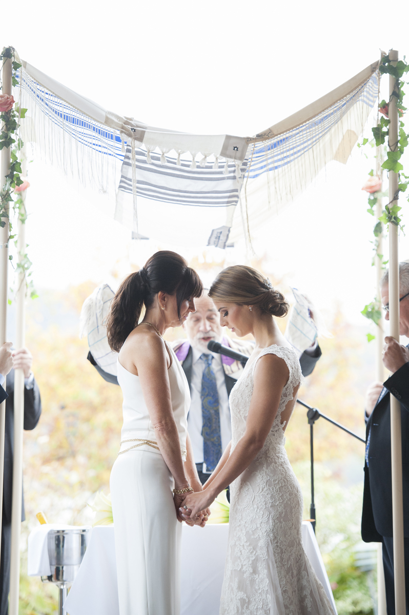 Brides during Jewish wedding ceremony. NYC wedding