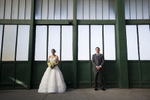 Bride and groom posing at train station in Liberty State Park before their wedding at Liberty House. Hoboken wedding photographers