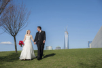 Bride and groom walking through Liberty State Park before their wedding at Liberty House. Hoboken wedding photographers