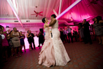 Brides dancing together for their first dance during the reception of their wedding at Liberty House. NYC gay-friendly wedding photographers