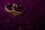 Creative ring shot of wedding rings at Liberty House. NYC wedding photographers