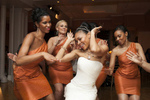 bride and bridesmaids dance-off at reception after wedding at Manhattan Penthouse. NYC wedding photographers