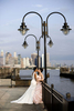 Portrait of brides at Liberty State Park before their wedding at Liberty House. Hoboken wedding photographers, NJ wedding photographers