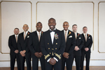 portrait of groom and groomsmen on wedding day at Manhattan Penthouse. NYC wedding photographers