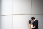 bride and groom kissing on wedding day at Hyatt Regency in Jersey City