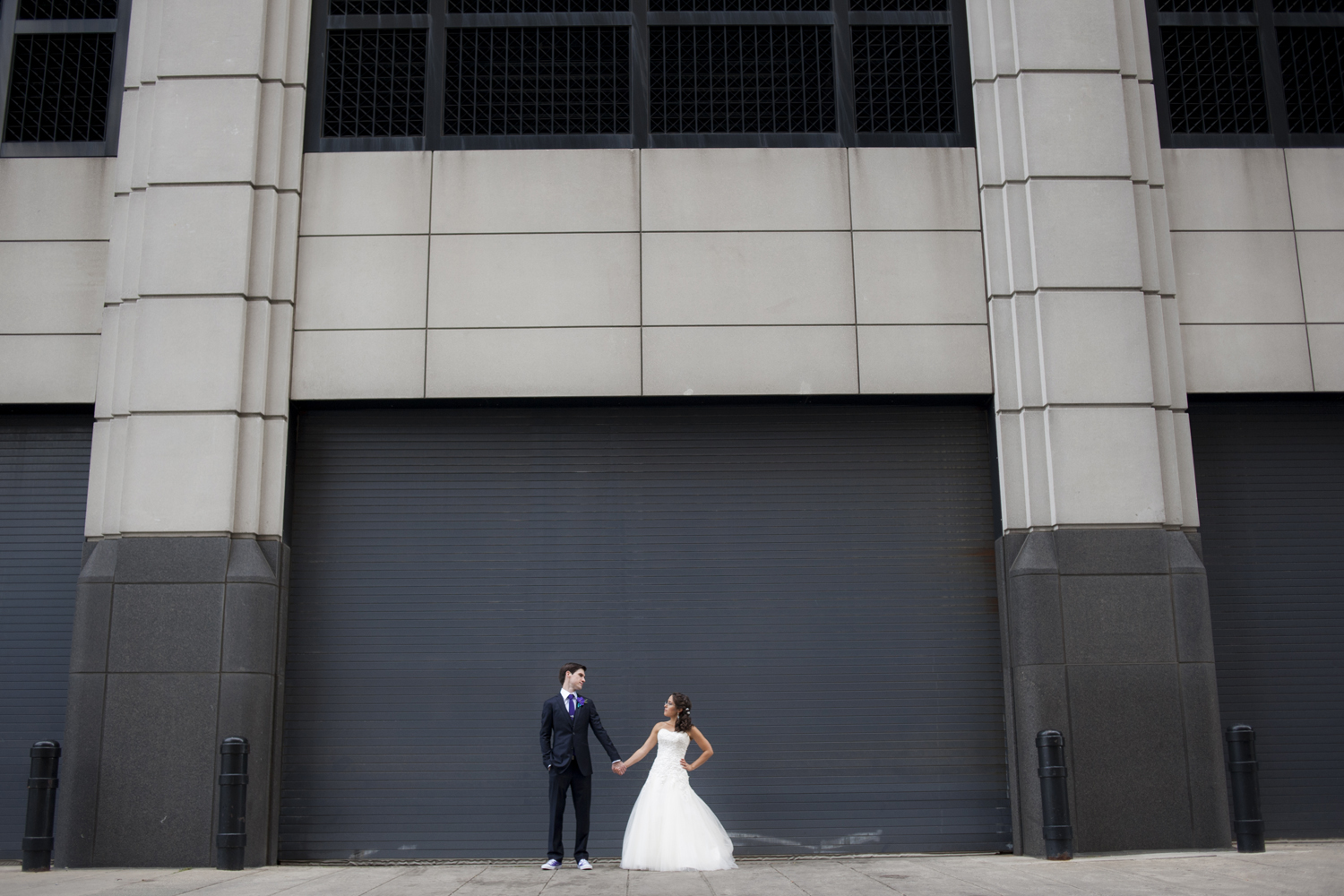 creative portrait of bride and groom on their wedding day in Jersey City