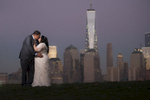 creative portrait of bride and groom in front of NYC skyline at night. Jersey City wedding photographers. NJ wedding photographers