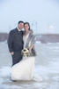 Blizzard wedding couple poses outside during winter weather. Hyatt Regency Jersey City wedding, Jersey City Wedding Photographers