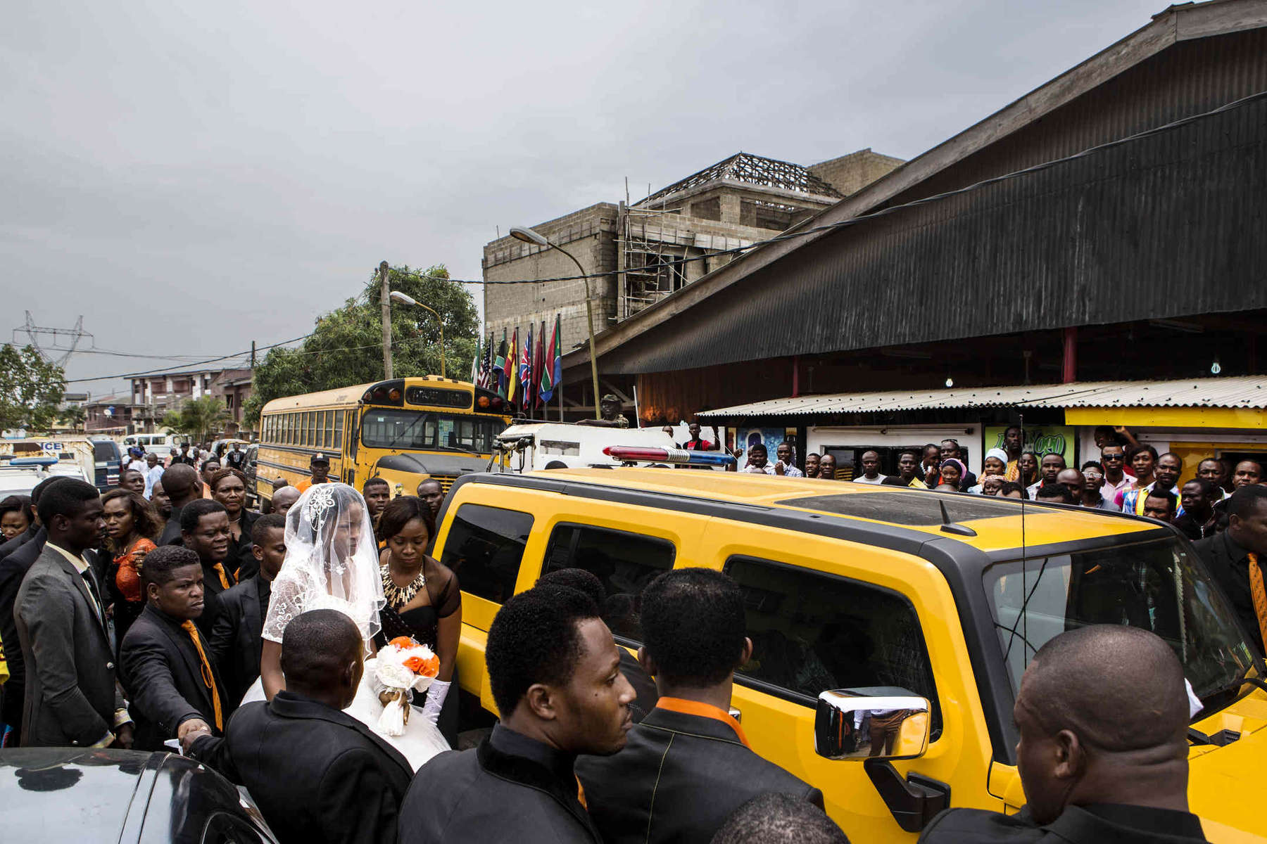 When the pastor of a mega church in a slum in Lagos got married on April 28, his bride arrived in a yellow Hummer.