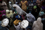 At the women's part of a Muslim wedding in conservative Northern Nigeria, trays of food and gifts are exchanged between the families of the bride and groom.