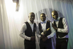 Caterers pose for picture with a bottle of champagne at a wedding in Abuja, Nigeria. After the French, the Nigerian's are the world's biggest consumers of champagne.