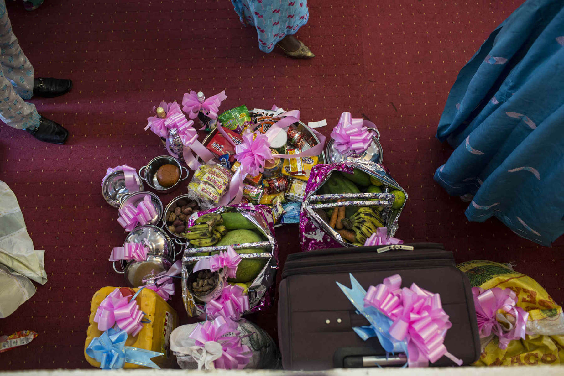 Gifts for a couple pile up. Common wedding gifts for middle and lower class Nigerians include suitcases, jerry cans, fruits and vegetables, and more.